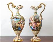 Sale 8774A - Lot 46 - A pair of Capodimonte porcelain ewers depicting typical pastoral scenes, marked 1366/119 the other 1366/119-110 height of each 54cm