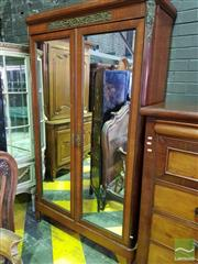 Sale 8539 - Lot 1097 - 1920s French Probably Mahogany Armoire, with brass mounts, two cross-banded mirror panel doors, enclosing an adjustable hanging shel...
