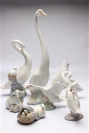 Sale 8706 - Lot 20 - A Lladro Figure of A Boy and Birds Together with Nao Examples ( A.F)