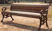 Sale 8871H - Lot 20 - Cast iron and teak bench seat. Height 77cm x Length 176cm x Depth 65cm