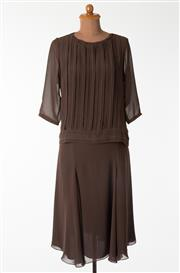 Sale 8550F - Lot 45 - A vintage Guy Laroche brown chiffon and silk two piece set comprising a mid length skirt and a top with transparent sleeves and plea...