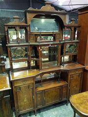 Sale 8653 - Lot 1031 - Late Victorian Rosewood & Marquetry Parlour Cabinet, the high back with several mirrors, shelves & glass panel doors, above a furthe...