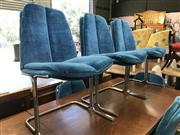 Sale 8868 - Lot 1535 - Set of 7 Chrome Based Upholstered Dining Chairs in Electric Blue
