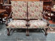 Sale 8848 - Lot 1093 - Pair of Louis XIV Style Walnut Armchairs, the square backs upholstered in a scenic patterned fabric, with carved arms and scrolled l...