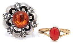 Sale 9115 - Lot 336 - VINTAGE SILVER AMBER AND CORAL RINGS; gilt ring set with an 8 x 6mm cabochon coral to split shoulders, size N, other claw set with a...