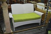 Sale 8398 - Lot 1079 - Four Piece Modern Wicker Outdoor Setting incl. Pair of Armchairs, Two Seater & Glass Top Coffee Table