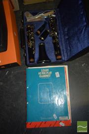 Sale 8509 - Lot 2302 - Cased Clarinet with Music Books