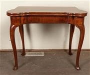 Sale 8871H - Lot 155 - An antique English mahogany folding card table C: Mid 1800s. The George II design table folding open to a swinging gate leg support...