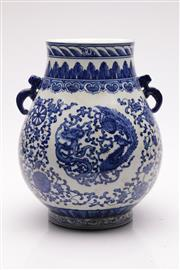 Sale 9057 - Lot 25 - A Chinese Blue and White Twin Handle Vase featuring Dragon and Phoenix Design (H 28cm)