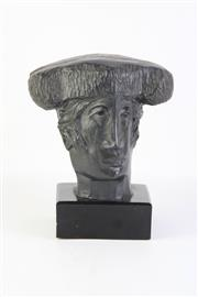 Sale 8796 - Lot 57 - Alvar ( Head of Matador) Patinated Foundry Stone ( H 19cm)