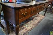 Sale 8520 - Lot 1035 - Georgian Oak Dresser Base, with three drawers with simulated cock-beading, raised on cabriole legs