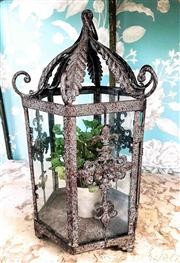 Sale 8577 - Lot 50 - A French provincial style rustic indoor/ outdoor decorative lantern with glass panels and faux pot plant, H 41 x W 25cm