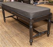 Sale 8709 - Lot 1039 - An ebonised painted elongated stool with charcoal cushion in the French taste, H x 46cm, L x 110cm, D x 40cm