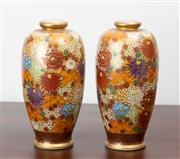 Sale 8774A - Lot 54 - A pair of Satsuma baluster vases depicting marigolds, marguerites and chrysanthemums, H x 18cm