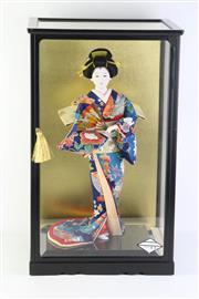Sale 8796 - Lot 70 - cased geisha doll (54cm x 33cm x 29cm)