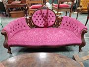 Sale 8925 - Lot 1020 - A carved and pink cut velvet upholstered button back love seat with leaf design