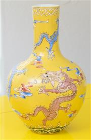Sale 9066H - Lot 46 - A Chinese bottle vase with five-claw dragon design in blue and pink, enamelled on a yellow ground, with character mark to base. H 38cm