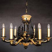Sale 8444A - Lot 6 - A handsome black and gold gilded chandelier with a detailed cast metal frame, elaborate leaf motifs symbolising ancient Greek power...