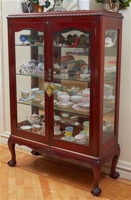 Sale 9098H - Lot 14 - A cedar glass display vitrine with mirrored back and shelved interior, raised on claw and ball feet, Height 139cm x Width 92cm x Dep...