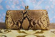 Sale 8577 - Lot 53 - A vintage snakeskin clutch with kiss clasp, gold hardware and felt lining, W 25 x H 12cm, Condition: Very Good