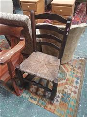 Sale 8666 - Lot 1081 - Provincial Elm Ladder Back Chair, with later rocking rails & rush seat