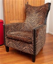 Sale 8891H - Lot 53 - A zebra print upholstered armchair with leather accents and studding, Height of back x 108cm, Width x 77cm, Depth 68cm