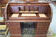 Sale 8335 - Lot 1099 - Victorian Mahogany Cylinder Desk, the cylinder with plum pudding veneer enclosing pigeon-holes, drawers & a slide-out writing surfac...