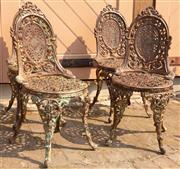Sale 8871H - Lot 39 - A set of four cast iron chairs. Height 86cm x Length 40cm x Width 40cm