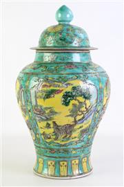 Sale 8902C - Lot 681 - Green Lidded Ginger Jar with Yellow Ground Panels decorated with cranes and tigers, mark to base, H44cm