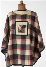 Sale 8550F - Lot 87 - A vintage Adam Bennett woollen poncho in cream, black and red tartan pattern with buttons at the back of the neck and a pocket to th...