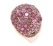 Sale 8991 - Lot 301 - A VINTAGE 18CT GOLD RUBY RING; dome top set with round cut rubies (1 missing), size P 1/2, wt. 5.56g.