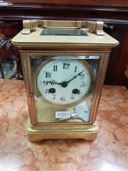 Sale 8868 - Lot 1083 - Late 19th/ Early 20th Century Brass Mantle Clock, fully glazed (one panel damaged), with white enamel dial