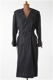 Sale 8550F - Lot 99 - A Burberry poly blend long navy raincoat with double breasted buttons, belt and tartan lining, size medium to large.