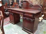 Sale 8576 - Lot 1058 - Victorian Mahogany Double Pedestal Sideboard, with low carved back, three frieze drawers & two carved panel doors