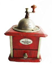 Sale 8828B - Lot 1 - An early C20th French painted red coffee grinder by Peugeot. Height 24cm