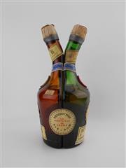 Sale 8532W - Lot 79B - 1x Dom Benedictine La Bouteille du Couple Liqueur - old bottling, some losses
