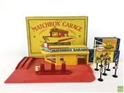 Sale 8559A - Lot 21 - Vintage Matchbox Garage, Showroom & Service Station in box, together with 2 Accessory Packs, Road signs no. 4 & Forecourt sign no. 1