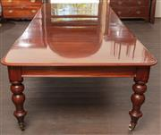 Sale 8871H - Lot 149 - An antique English mahogany 12 seat 3 leaf extension dining table C: 1870. The 3 original leaves easily removed by a crank winding m...