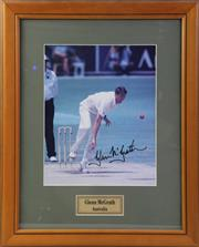 Sale 8994W - Lot 646 - A Signed Glenn Mcgrath Bowling Photograph (54cm x 43cm)