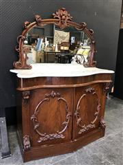 Sale 9048 - Lot 1053 - Victorian Mahogany Credenza, the mirror back with carved fruit crest, above a white serpentine marble top, concealed friexe drawer &...