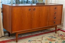 Sale 9164H - Lot 69 - A Parker teak sideboard raised on four legs, Height 73cm x Width 137cm x Depth 45cm