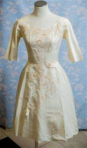 Sale 8577 - Lot 60 - A 1950s vintage satin wedding dress featuring flower appliques and faux pearl embellishments, fully layered skirt and metal zipper,...