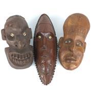 Sale 8607R - Lot 94 - Three Decorative Timber Tribal Masks (H: 45cm) -