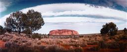 Sale 9252A - Lot 5032 - KEN DUNCAN Uluru Cloudscape photograph, ed 11/50 32 x 76 cm (frame: 51 x 96 x 4 cm, crack to glass) signed lower right