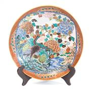 Sale 8439A - Lot 73 - A Japanese Kutani charger, brightly painted with birds amongst flowering foliage, markings to base, includes timber stand, W 39cm