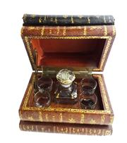 Sale 8828B - Lot 4 - An Art Deco French secret book stack tantalus, 1 bottle & 4 glasses, some small wear to edges. 18 x 12 x 14cm