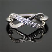 Sale 8299J - Lot 303 - AN INFINITY DIAMOND RING; set in silver with 12 graduated single cut diamonds, N 1/2.
