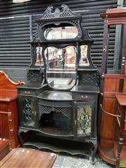 Sale 8576 - Lot 1025 - Edwardian Ebonised & Carved Parlour Cabinet, the back with multiple shaped mirrors & shelves, above a niche, two drawers, two astrag...
