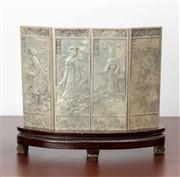 Sale 8774A - Lot 63 - A Chinese white metal tablet screen depicting ladies in various landscapes and poses in timber stand, total H x 17.5cm