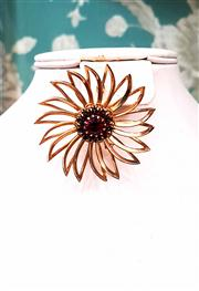 Sale 8577 - Lot 62 - A vintage goldtone flower brooch with ruby coloured crystal centre, diam 5.5cm, Condition: Excellent